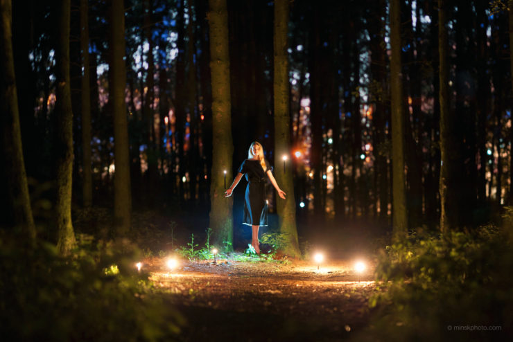 Night forest levitation witch candles photoshoot